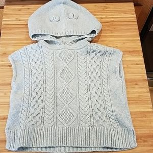 Hooded, sleeveless cable knit sweater vest